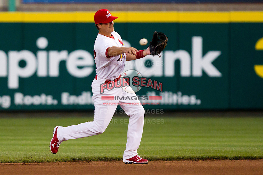 Eric Duncan (15) of the Springfield Cardinals throws to first base during a game against the Tulsa Drillers on April 29, 2011 at Hammons Field in Springfield, Missouri.  Photo By David Welker/Four Seam Images.