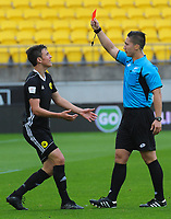 Referee Calvin Berg red cards Phoenix' Ronan Wynne during the ISPS Handa Premiership football match between Wellington Phoenix Reserves and Waitakere United at Westpac Stadium in Wellington, New Zealand on Saturday, 3 November 2018. Photo: Dave Lintott / lintottphoto.co.nz