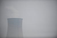 Daytime landscape view from a train of a cooling tower at a commercial heavy industry site near Wuhan in Hubei Province.  © LAN