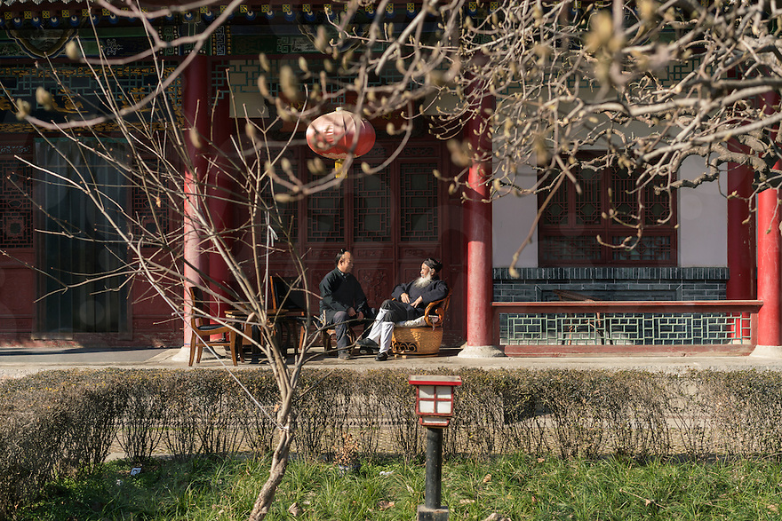January 12, 2017 - Tayu village, Shaanxi (China). Ren Farong (right) - one of the highest ranking Taoist master in China - chats with another monk in the courtyard of the Louguantai temple. © Thomas Cristofoletti / Ruom for Sixthtone