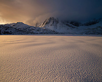Winter sunrise over frozen lake Storvatnet, Flakstadøy, Lofoten Islands, Norway