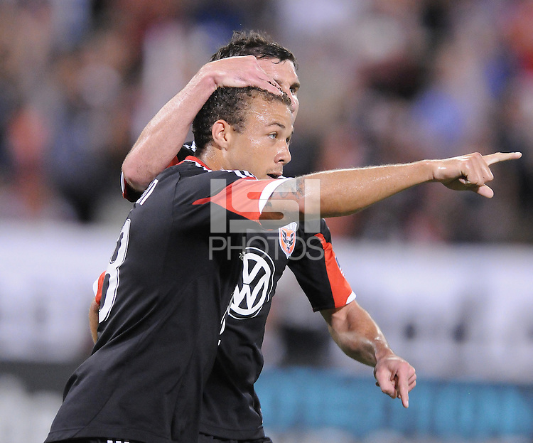D.C. United defender Nick DeLeon (18) celebrates his score in the 21th minute of the match with teammate Chris Pontius. The New York Red Bulls tied D.C. United 2-2 at RFK Stadium, Wednesday August 29, 2012.