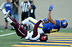 BROOKINGS, SD - OCTOBER 7: Skyler Cavanaugh #43 from South Dakota State University rolls over Tory Lewis #14 from Southern Illinois in the end zone in the first half of their game Saturday night at Dana J. Dykhouse Stadium in Brookings. (Photo by Dave Eggen/Inertia)