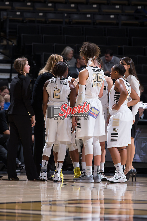 The Wake Forest Demon Deacons huddle up during a stoppage in play late in the second half of the game against the Louisville Cardinals at the LJVM Coliseum on January 11, 2015 in Winston-Salem, North Carolina.  The Cardinals defeated the Demon Deacons 79-68.  (Brian Westerholt/Sports On Film)