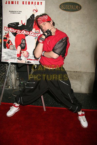 "JAMIE KENNEDY .""Kickin' It Old Skool"" Los Angeles Premiere Party at the Music Box Theatre, Hollywood, California, USA..April 25th, 2007.full length red bandana studded bracelet fingerless leather black gloves fishnet trousers zipper posing legs spread .CAP/ADM/BP.©Byron Purvis/AdMedia/Capital Pictures"