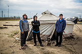 Makeshift tent camp at the serbian side of the border where the conatiner camp being built in hugary. Three afgani and one nepali men waiting in one of the tents. They are on the waiting list, (only five applicants processed per day).