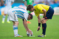 Referee Nicola Rizzoli marks the spot with vanishing spray for Lionel Messi of Argentina