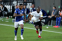 30th July 2020; Craven Cottage, London, England; English Championship Football Playoff Semi Final Second Leg, Fulham versus Cardiff City; Neeskens Kebano of Fulham competes for the ball with Leandro Bacuna of Cardiff City