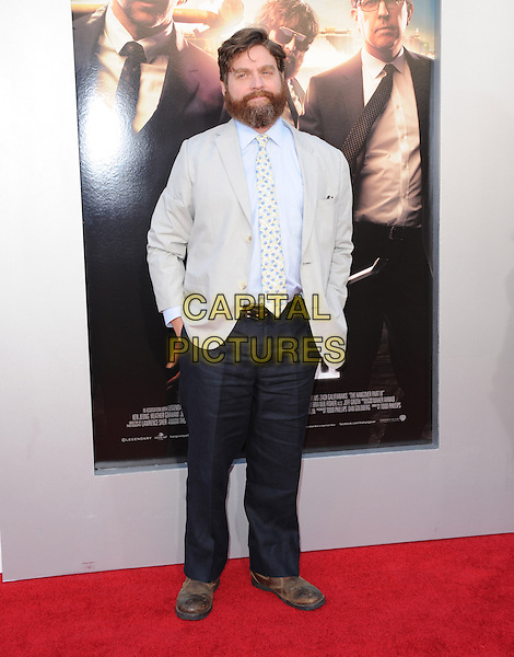 "Zach Galifianakis.""The Hangover Part III"" Los Angeles Premiere held at the Westwood Village Theater, Los Angeles, California, USA..May 20th, 2013.full length trousers beard facial hair blue yellow tie floral print shirt grey gray.CAP/DVS.©DVS/Capital Pictures"