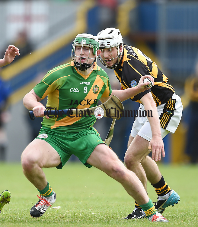 Conor Cooney of O Callaghan's Mills in action against Pat O Connor of Tubber during their match in Ennis. Photograph by John Kelly.