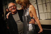 NEW YORK - FEB 4: Maz Arzia and a model at his fashion show at Fashionweek at Bryant Park, 2008. (Photo by Landon Nordeman)