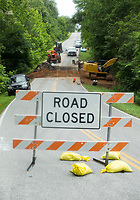 NWA Democrat-Gazette/BEN GOFF @NWABENGOFF<br /> A barricade closes the road as a crew from Crossland Heavy Contractors work Wednesday, July 10, 2019, on a tunnel construction on Highlands Boulevard in Bella Vista. The tunnel is one of the eleven namesake tunnels planned for the 11 Under trail system under construction on the West side of Bella Vista.