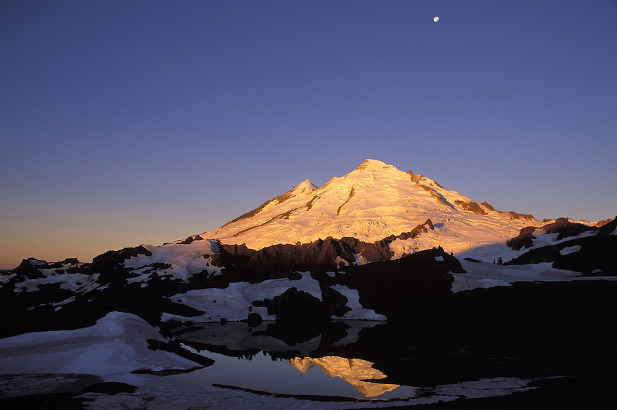 Moon above Mt Baker reflected in 14-Goat Lake at sunrise, North Cascades, Cascade Mountains, Washington