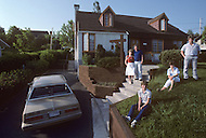 Ile D'Orleans, Quebec City Area, Canada, June 8, 1984. A family in front of their house.