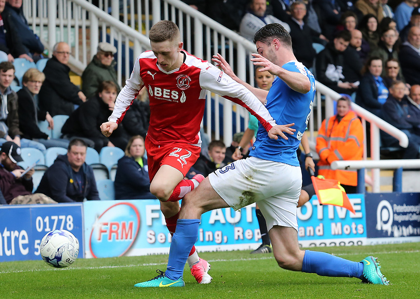 Fleetwood Town's Ashley Hunter is tackled by Peterborough United's Andrew Hughes<br /> <br /> Photographer David Shipman/CameraSport<br /> <br /> The EFL Sky Bet League One - Peterborough United v Fleetwood Town - Friday 14th April 2016 - ABAX Stadium  - Peterborough<br /> <br /> World Copyright &copy; 2017 CameraSport. All rights reserved. 43 Linden Ave. Countesthorpe. Leicester. England. LE8 5PG - Tel: +44 (0) 116 277 4147 - admin@camerasport.com - www.camerasport.com