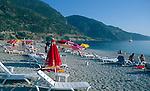Sunbathing on the beach at Olu Deniz, Fethiye, Turkey