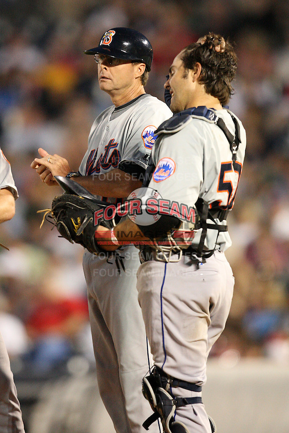 Binghamton Mets Manager Tim Teufel (11) and catcher Mike Nickeas (50) during a game vs. the Akron Aeros at Eastwood Field in Akron, Ohio;  June 25, 2010.   Binghamton defeated Akron 5-3.  Photo By Mike Janes/Four Seam Images