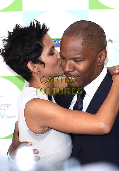 HALLY BERRY & JAMIE FOXX.2010 Jenesse Silver Rose  Gala & Auction held at The Beverly Hills Hotel, Beverly Hills, California, USA..April 18th, 2010.black white blue goatee facial hair jaime half length profile mouth open grey gray beige sleeveless kiss kissing .CAP/ADM/TC.©T. Conrad/AdMedia/Capital Pictures.
