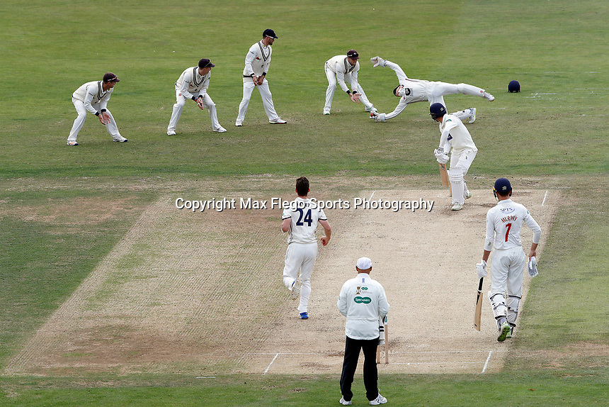 Sam Billings of Kent takes an acrobatic catch to dismiss Ruaidhri Smith of Glamorgan off the bowling of Matt Henry during the Specsavers County Championship division two game between Kent and Glamorgan (day 3) at the St Lawrence Ground, Canterbury, on Sept 20, 2018
