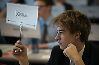 "Elias Delaca, from West Valley High School, casts Botswana's vote on a resolution during committee sessions for the Model United Nations of Alaska 2018 Conference in UAA's Rasmuson Hall. The 36th Annual Model U.N.  of Alaska conference, hosted by UAA's Department of Political Science, was titled ""Global Cooperation Under Siege."""