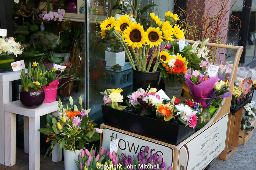 Spring flower display outside a florist shop in Yaletown, Vancouver, British Columbia, Canada