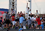 Fans in centerfield of the Reno Aces stadium try to come up with the ball during the Triple-A All Star Home Run Derby in Reno, Nev., on Monday, July 15, 2013. <br /> Photo by Cathleen Allison