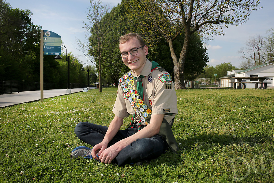 NWA Democrat-Gazette/DAVID GOTTSCHALK  Hogan Maestri, 17, sits Friday, April 14, 2017, in the location of his proposed Fallen Soldier Memorial at Shiloh Memorial Park in Springdale. Hogan is raising money to have a Fallen Soldier Memorial at the park. The bronze monument will honor those from Springdale who died in battle while serving the military for the United States. The project is his Eagle scout service project. He hopes to raise $15,000, the cost of the monument, before his 18th birthday on July 28.