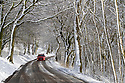 28/01/120<br /> <br /> A car makes its way down a picturesque tree-lined road below Mam Tor, near Castleton in the Derbyshire Peak District..<br /> <br /> <br /> All Rights Reserved: F Stop Press Ltd.  <br /> +44 (0)7765 242650 www.fstoppress.com