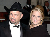 Country singers Garth Brooks and Trisha Yearwood pose for photographers as they arrive at the John F. Kennedy Center for the Performing Arts in Washington, DC on December 7, 2003.   They were in town to honor the 2003 recipients of the Kennedy Center Honors.  The recipients are: actress Carol Burnett , musician James Brown , singer Loretta Lynn, director Mike Nichols and violinist Izthak Perlman..Credit: Ron Sachs / CNP