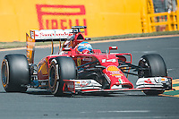 March 14, 2014: Fernando Alonso (ESP) from the Scuderia Ferrari team exits turn four during practice session one at the 2014 Australian Formula One Grand Prix at Albert Park, Melbourne, Australia. Photo Sydney Low.