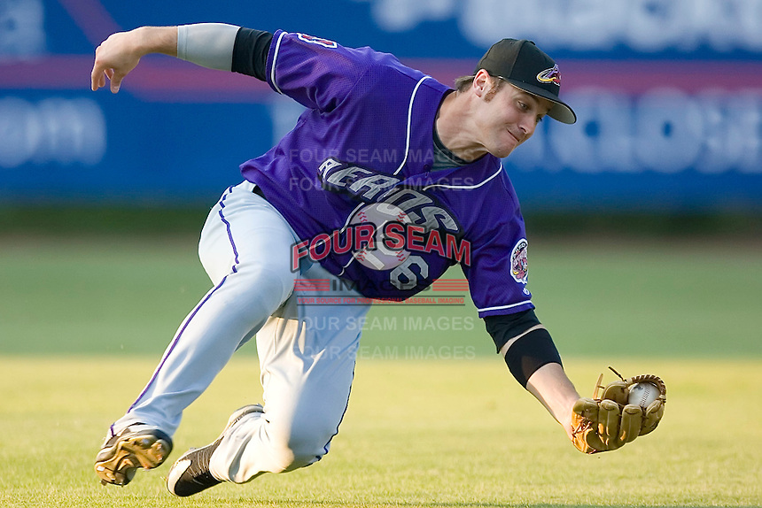 Left fielder Trevor Crowe (26) of the Akron Aeros stretches to catch a fly ball at Prince Georges Stadium in Bowie, MD, Tuesday June 17, 2008.