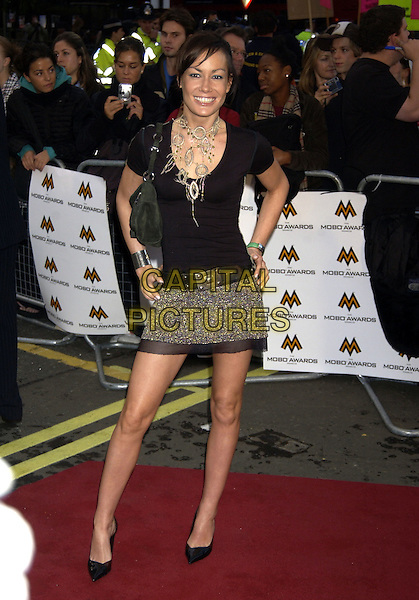 TARA PALMER TOMPKINSON.MOBO Awards.Music of Black Origin.Royal Albert Hall.London 30 September 2004.Ref: PL.full length TPT silver mini skirt black top big necklace skinny thin.www.capitalpictures.com.sales@capitalpictures.com.©Capital Pictures.