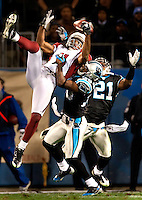 Arizona Cardinals wide receiver Larry Fitzgerald (11) fights for the ball against Carolina Panthers FS Charles Godfrey (30) during the NFC Divisional Playoff football game at Bank of America Stadium, in Charlotte, NC. Arizona defeated the Carolina Panthers 33-13.