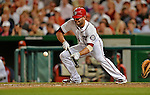 18 May 2012: Washington Nationals second baseman Danny Espinosa lays down a sacrifice bunt against the Baltimore Orioles at Nationals Park in Washington, DC. The Orioles defeated the Nationals 2-1 in the first game of their 3-game series. Mandatory Credit: Ed Wolfstein Photo