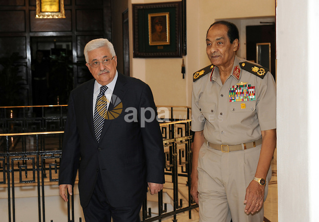 Egyptian Field Marshal Hussein Tantawi, head of the Egyptian Armed Forces Supreme Council meets with Palestinian Mahmoud Abbas during his three days visit, in Cairo, Egypt on Sep. 14,2011. Abbas, who arrived in Cairo on 12 September, met with Arab League officials as well with EU Foreign Affairs Chief Catherine Ashton, some one week ahead of his bid to gain recognition of statehood and membership from the United Nations General Assembly on 19 September. Photo by Thaer Ganaim