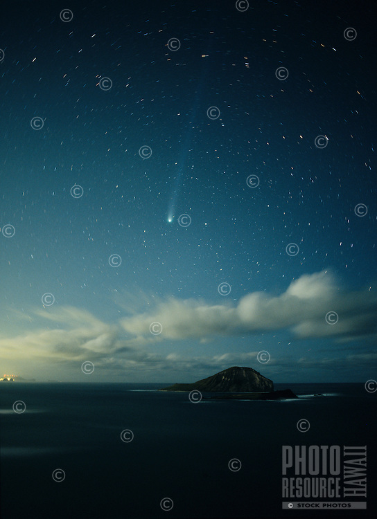 Comet Hyakutake over Rabbit Island, Oahu, Hawaii..The comet is in far northern sky next to the pole star, Polaris.