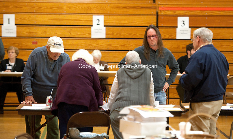 WINSTED,  CT-110816JS02-Winsted voters get questions answered by moderators during election day Tuesday at Pearson Middle School in Winsted <br /> Jim Shannon Republican American