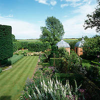 A pair of copper-roofed 17th century-style pavillions provide a transition from the rose garden to the physic garden