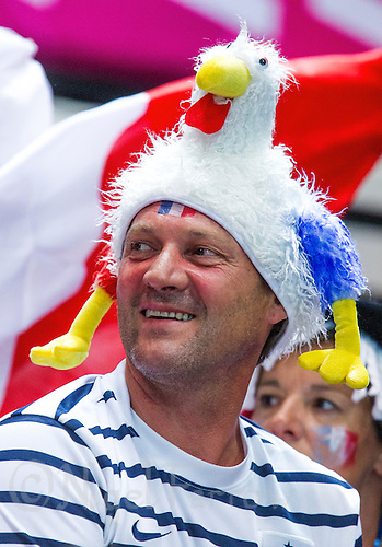 28 JUL 2012 - LONDON, GBR - A French supporter watches the women's London 2012 Olympic Games Preliminary round handball match between France (FRA) and Norway at The Copper Box in Olympic Park, in Stratford, London, Great Britain. (PHOTO (C) 2012 NIGEL FARROW)