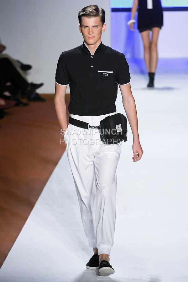 Model walks the runway in an outfit by Christopher Lemaire, for the Lacoste Spring Summer 2011 runway fashion show, during Mercedes-Benz Fashion Week, September 11, 2010.