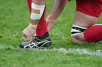 A general view of a Harlequins player tying his rainbow laces during the pre-match warm-up. Aviva Premiership match, between Bath Rugby and Harlequins on November 25, 2017 at the Recreation Ground in Bath, England. Photo by: Patrick Khachfe / Onside Images
