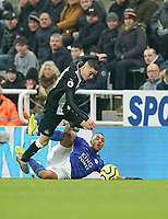 1st January 2020; St James Park, Newcastle, Tyne and Wear, England; English Premier League Football, Newcastle United versus Leicester City; Youri Tielemans of Leicester City fouls Miguel Almiron of Newcastle United - Strictly Editorial Use Only. No use with unauthorized audio, video, data, fixture lists, club/league logos or 'live' services. Online in-match use limited to 120 images, no video emulation. No use in betting, games or single club/league/player publications