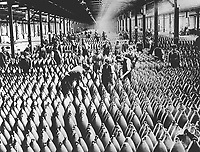 English women in munition factory.  Women and men working in storage shed for large shells.  In most of the munition centers the Y.W.C.A. has established cafeterias and shampoo parlors.  Ca.  1918-19.  (Women's Bureau)<br />