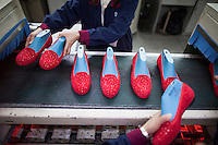 A worker is seen on the production line at the Haujian Group shoe factory in Dongguan, Guangdong Province, China, 04 March 2015. Workers at the Huajian factory in Guangdong make a salary of USD500 per month - five times more than their Ethiopian counterparts at the Huajian shoe factory in Addis Abbaba, Ethiopia.