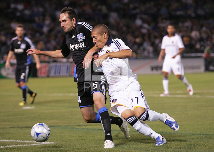 Ryan Cochrane (5) controls the ball against Bryan Jordan (27). San Jose Earthquakes tied Los Angeles Galaxy 1-1 at the McAfee Colisum in Oakland, California on April 18, 2009.