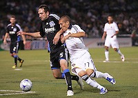 Ryan Cochrane (5) controls the ball against Bryan Jordan (27). San Jose Earthquakes tied Los Angeles Galaxy 1-1 at the McAfee Colisum in Oakland, California on April 18, 2009.
