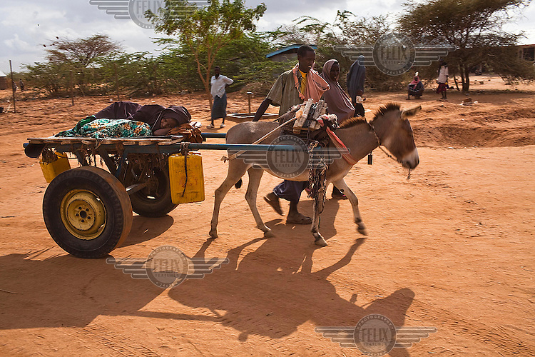 A Somali refugee brings a patient on a donkey pulled cart to the stabilizsation centre at the IFO-1 camp part of the Dadaab refugee camp in Kenya. The drought is the worst in East Africa for 60 years. The UN described it as a humanitarian emergency. The already overcrowded complex received 1,000 new refugees a day in June, five times more than a year ago. About 30,000 people arrived at the Dadaab refugee camp in June, according to UNHCR compared to 6,000 in June 2010.