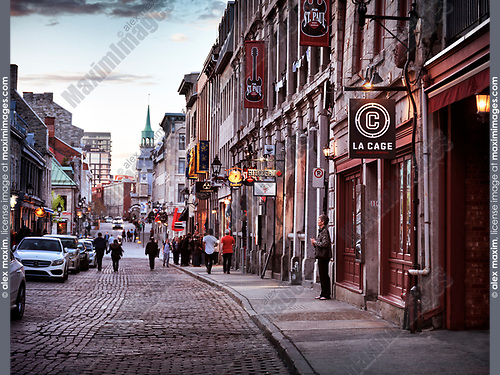 La Cage, Bilodeau, St Paul pub and other shops and restaurants on Rue St Paul historic street of old town in Montreal, Quebec, Canada at sunset. Rue Saint Paul Est, Ville de Montréal, Québec, Canada 2017.