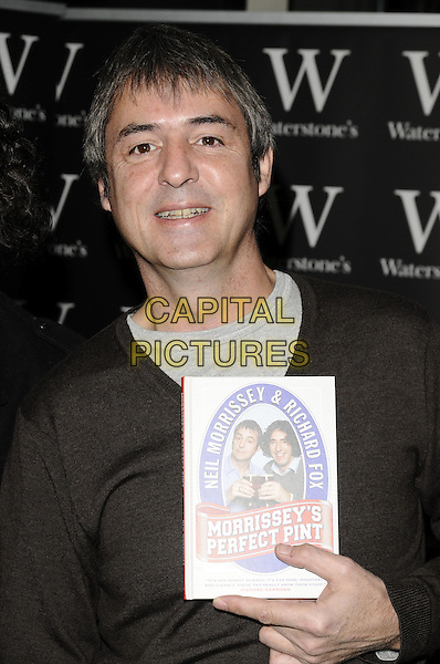 "NEIL MORRISSEY.Booksigning session of ""Morrissey's Perfect Pint"", Waterstone's bookshop, Leadenhall Market, London, England..November 10th, 2008.book signing half length brown jumper.CAP/CAN.©Can Nguyen/Capital Pictures."