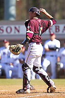 Catcher Jimmy Holton #11 of the College of Charleston Cougars throws the ball back to his pitcher during the game against the Davidson Wildcats at Wilson Field on March 12, 2011 in Davidson, North Carolina.  The Wildcats defeated the Cougars 8-3.  Photo by Brian Westerholt / Four Seam Images
